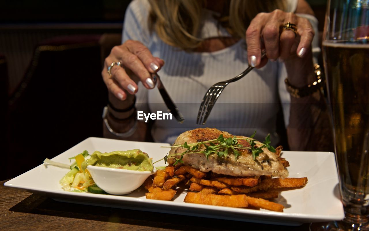 Midsection Of Woman At Restaurant