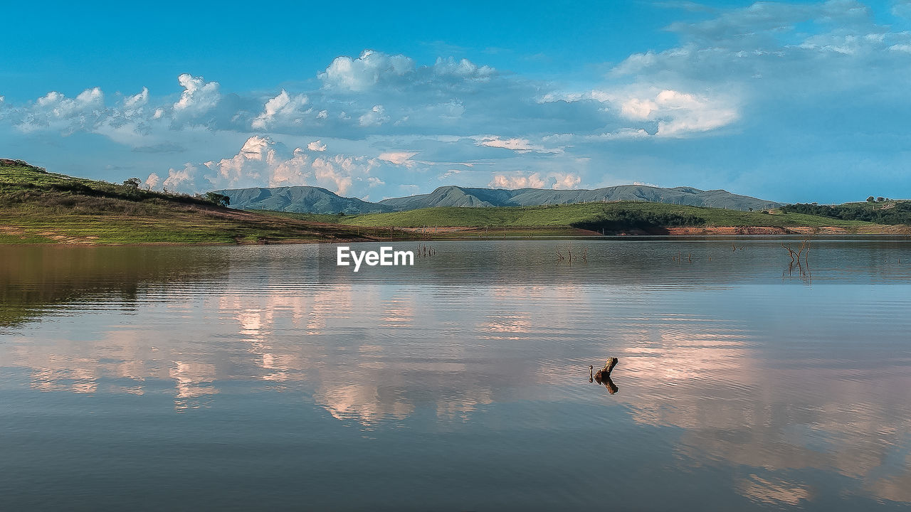 water, sky, mountain, beauty in nature, reflection, scenics - nature, cloud - sky, waterfront, bird, vertebrate, lake, animal, animals in the wild, animal wildlife, tranquility, animal themes, nature, tranquil scene, non-urban scene, no people, outdoors