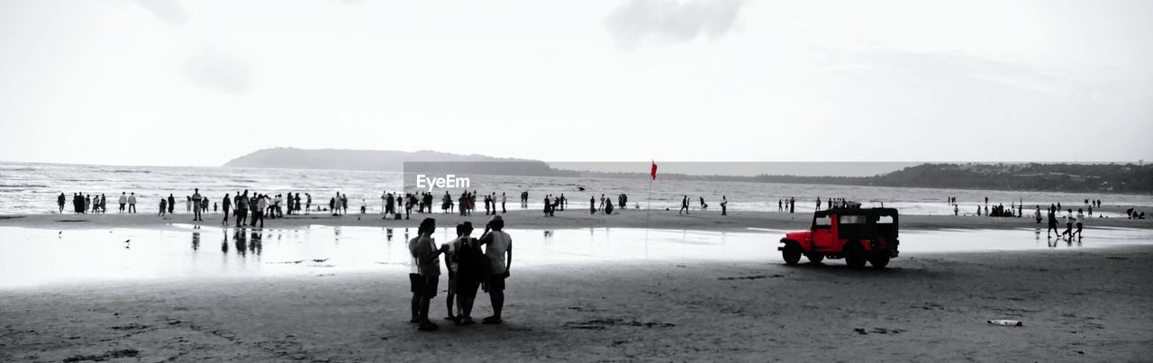 beach, large group of people, real people, sand, nature, leisure activity, sea, vacations, lifestyles, cold temperature, outdoors, men, winter, water, women, sky, day, scenics, beauty in nature, travel destinations, mountain, people, adult