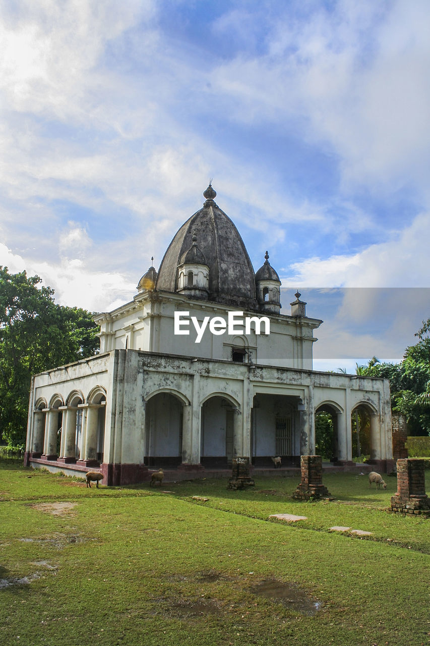 built structure, architecture, building exterior, sky, grass, cloud - sky, nature, building, plant, day, religion, place of worship, dome, belief, spirituality, arch, history, no people, outdoors, the past, ancient civilization