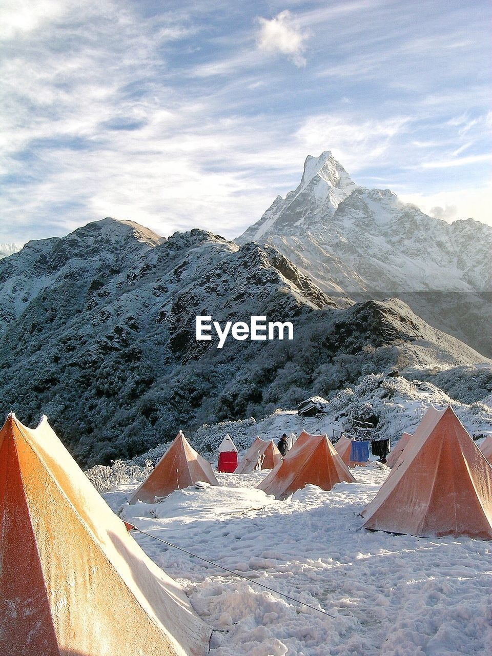 mountain, snow, mountain range, snowcapped mountain, beauty in nature, cold temperature, nature, scenics, sky, day, outdoors, tranquil scene, cloud - sky, winter, tranquility, travel destinations, landscape, no people