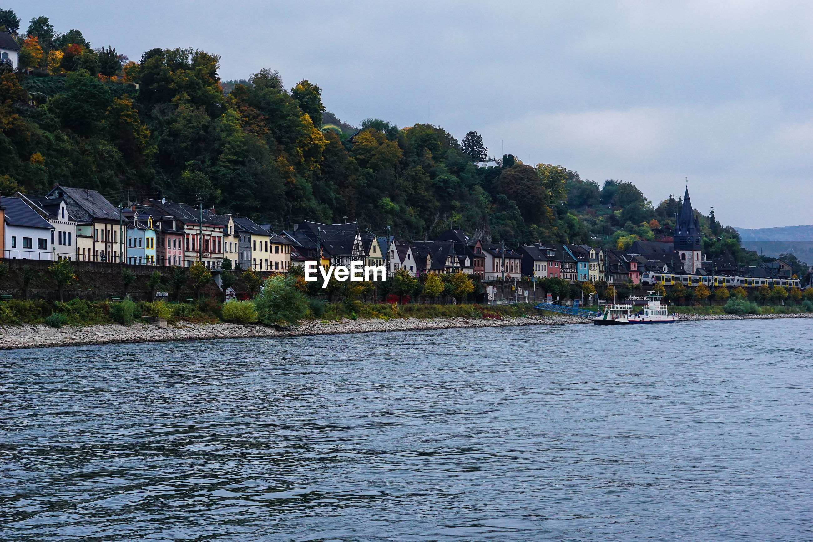 Town by river rhine against sky