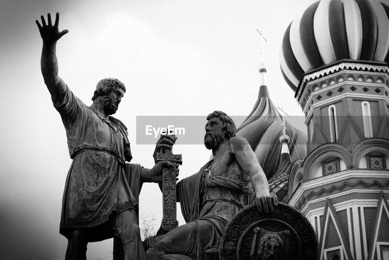 Low angle view of statues against saint basil cathedral