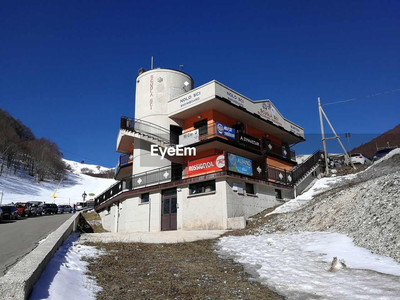 snow, cold temperature, sky, winter, nature, architecture, clear sky, built structure, day, white color, mountain, building exterior, no people, blue, water, frozen, covering, transportation, outdoors, snowcapped mountain