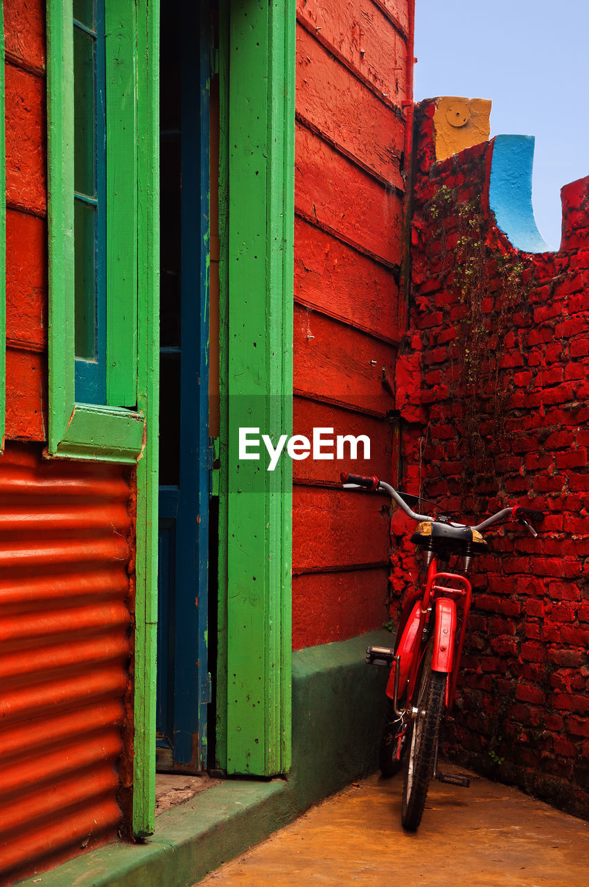 Red Bicycle Against Brick Wall
