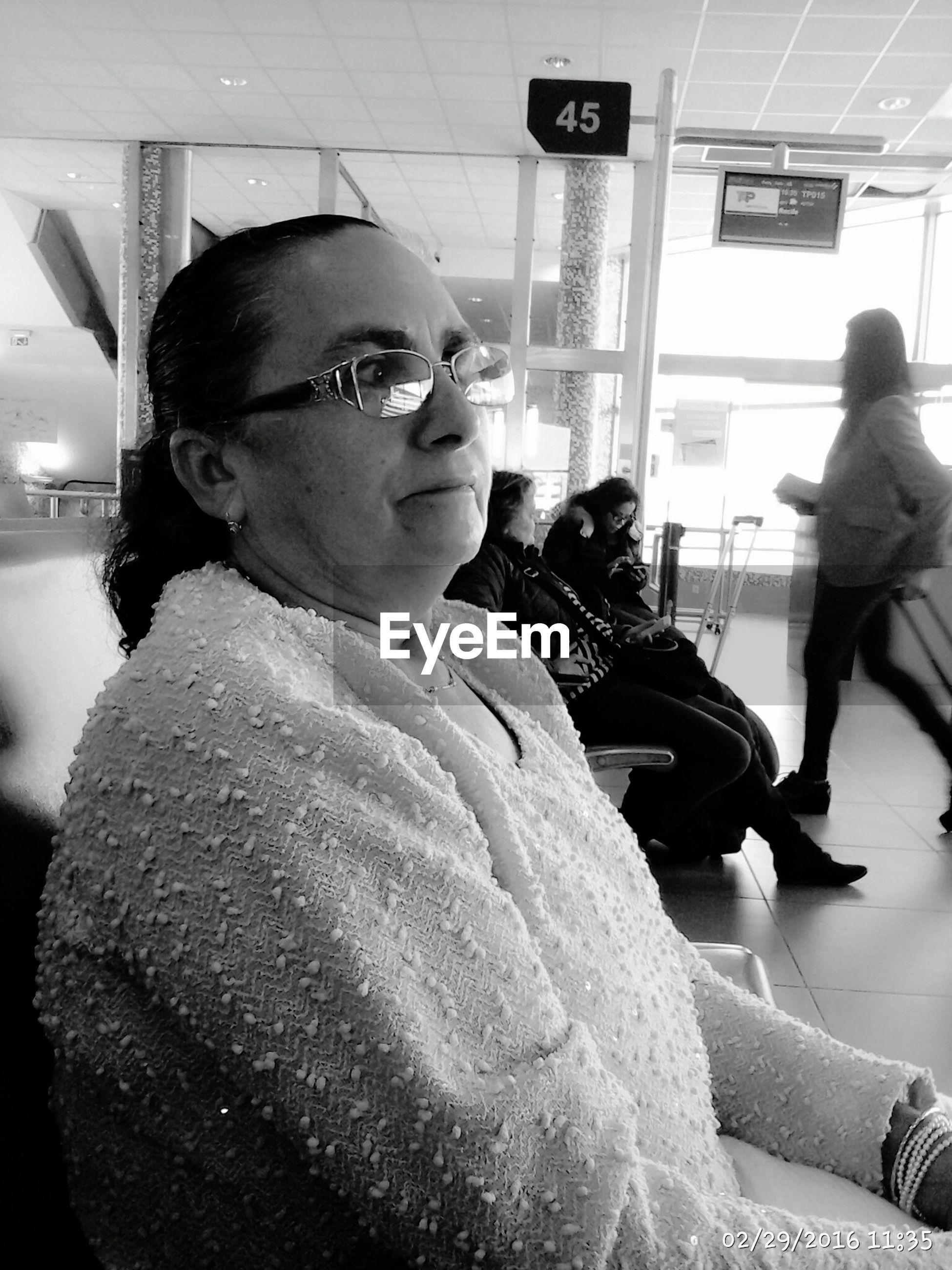 Close-up of mature woman at airport