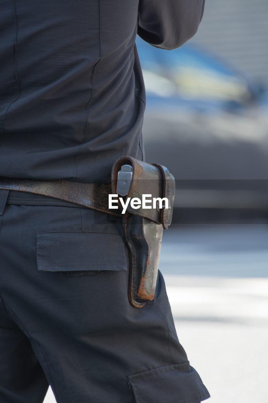 Close-up of man with gun holster