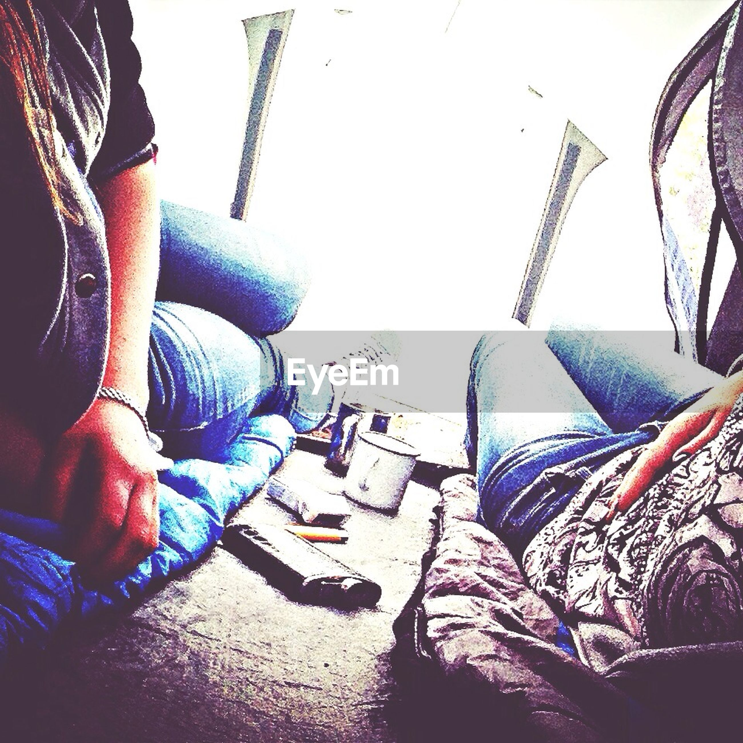 low section, person, shoe, chair, jeans, relaxation, indoors, textile, part of, blue, close-up, high angle view, footwear, personal perspective, fashion, sunlight, day, lifestyles