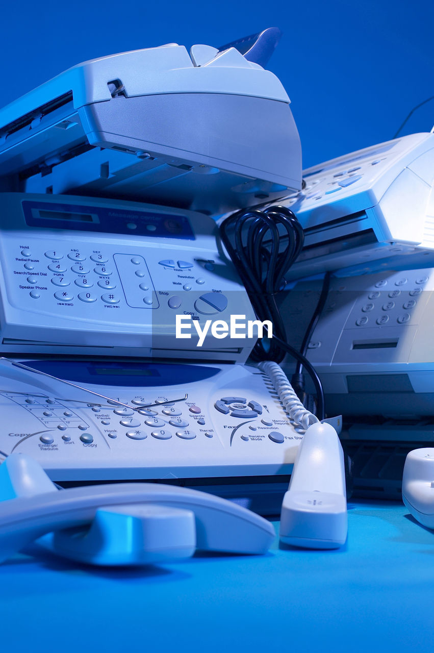 blue, no people, close-up, technology, still life, indoors, paper, communication, connection, table, document, business, number, computer, equipment, education, book, wireless technology, office, paperwork, keyboard