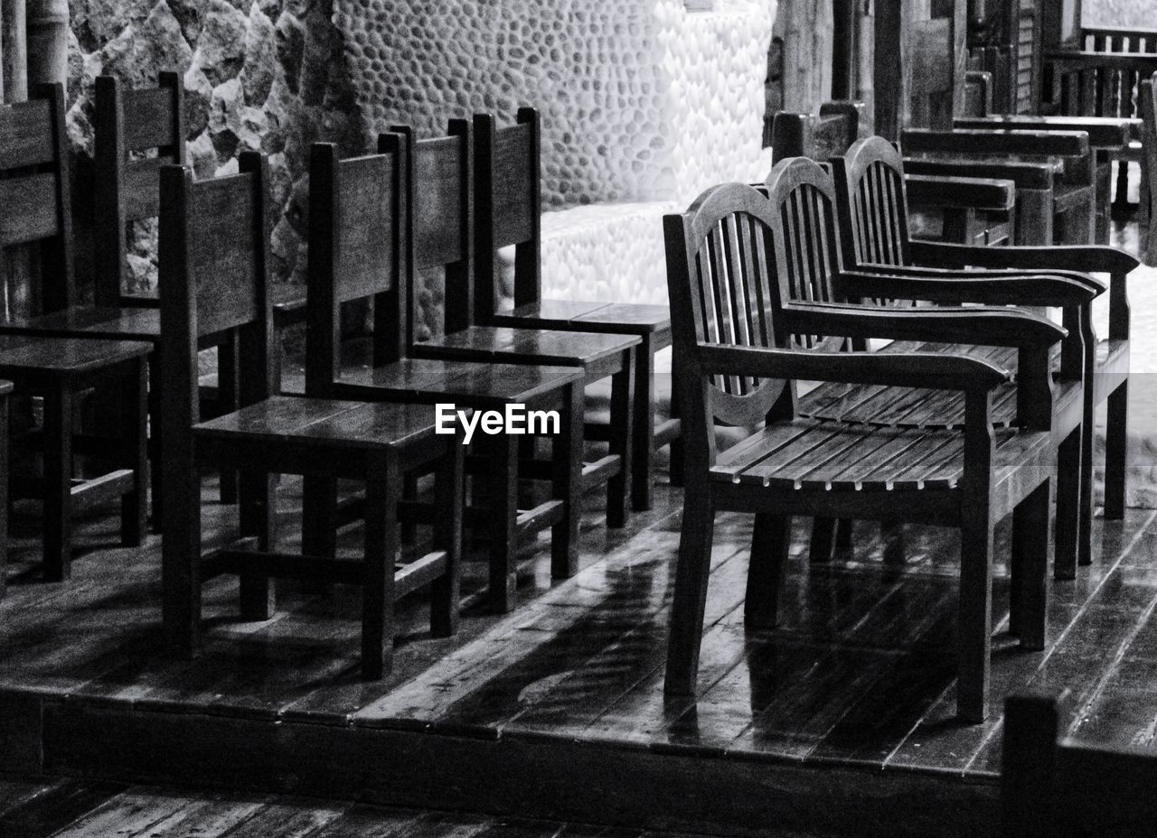 seat, chair, absence, empty, in a row, no people, table, indoors, architecture, day, wood - material, arrangement, building, built structure, order, furniture, group of objects, bench, relaxation