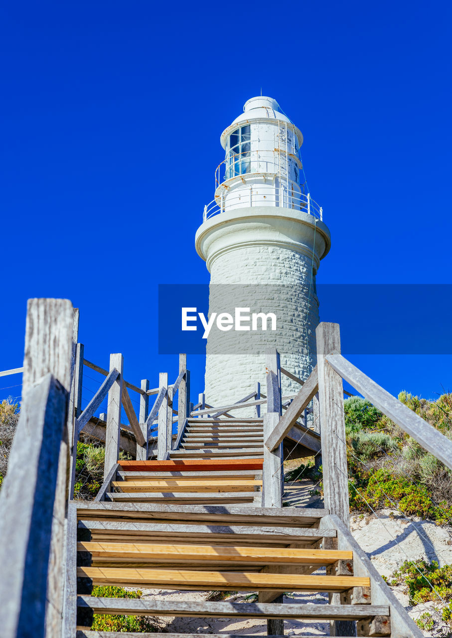 blue, clear sky, architecture, built structure, steps, day, outdoors, no people, low angle view, steps and staircases, building exterior, lighthouse, nature, sky