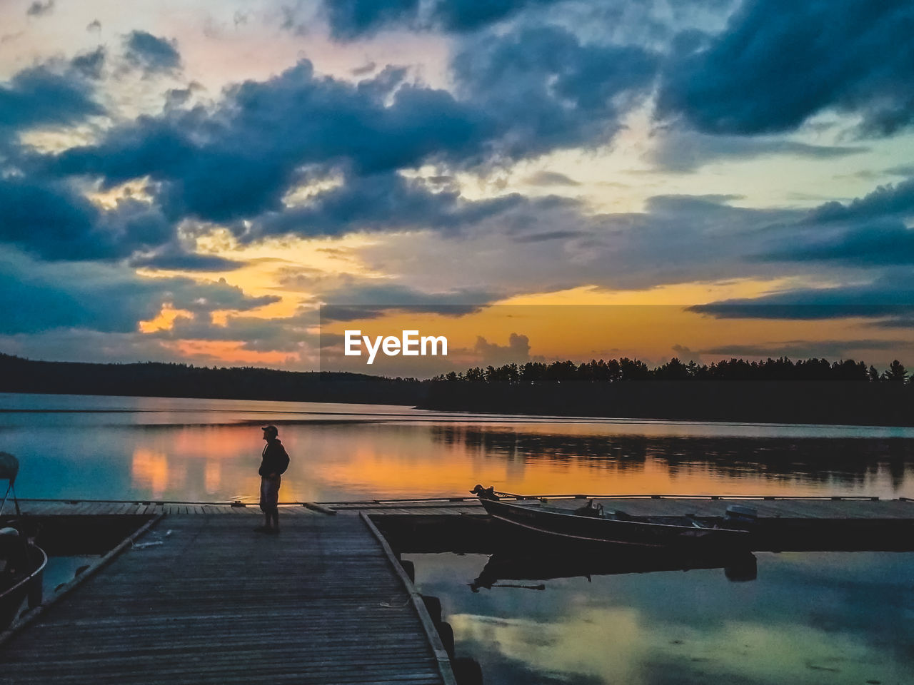 SCENIC VIEW OF PIER ON LAKE AGAINST SKY DURING SUNSET