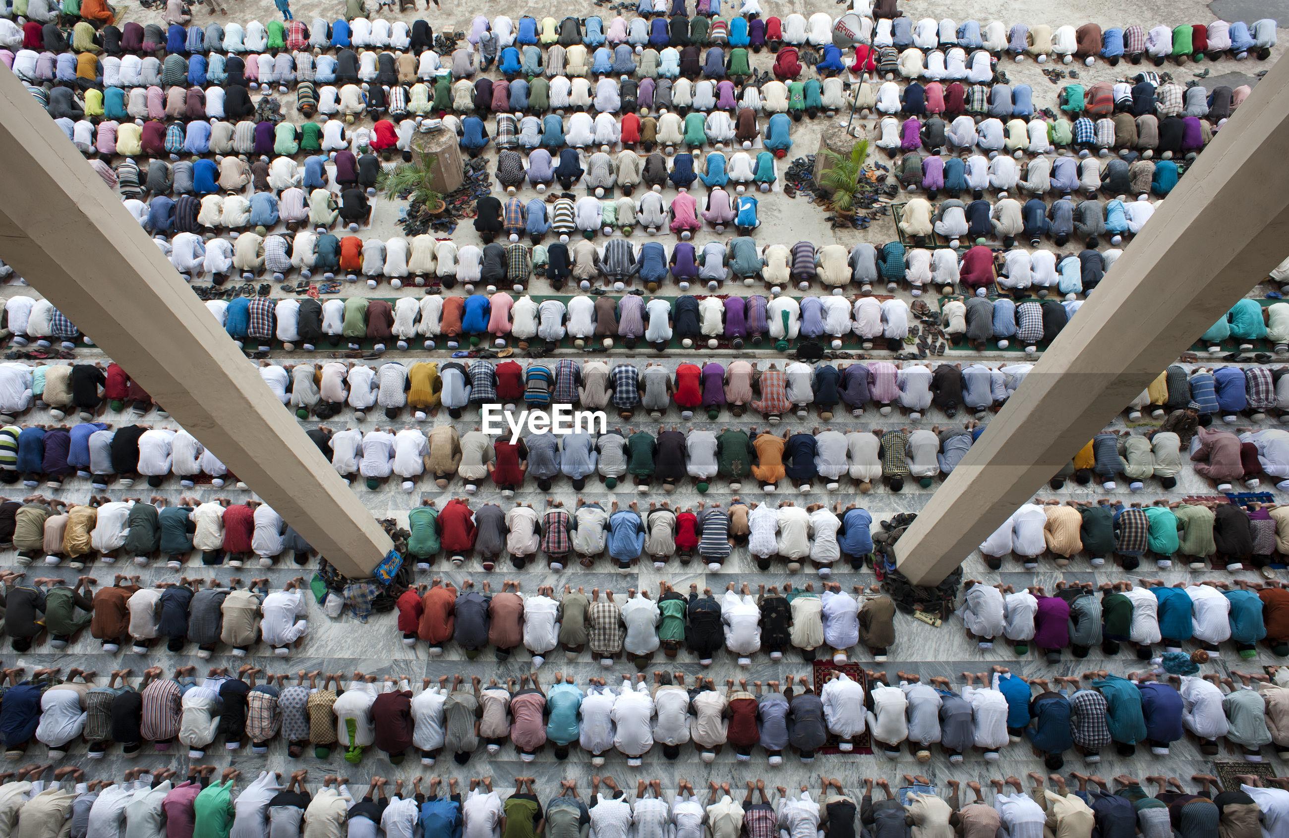Large group of muslim people praying