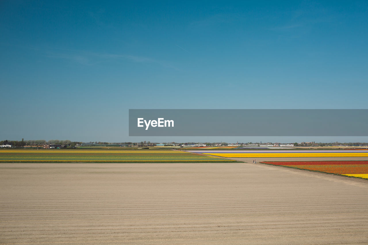 sky, transportation, road, landscape, no people, nature, clear sky, blue, copy space, environment, day, beauty in nature, scenics - nature, field, tranquility, outdoors, sunlight, tranquil scene, airport, land