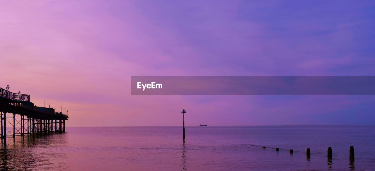 sea, water, beach, beauty in nature, tranquil scene, scenics, tranquility, nature, horizon over water, sunset, wooden post, outdoors, sky, idyllic, no people, sand, day