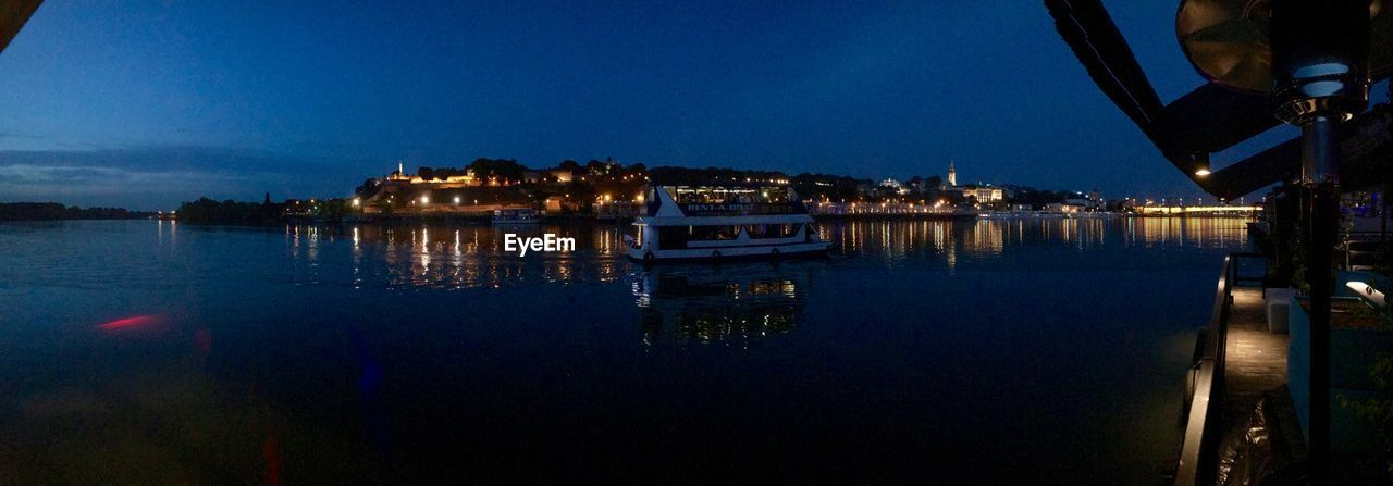 water, reflection, sky, illuminated, architecture, built structure, night, building exterior, nautical vessel, city, transportation, mode of transportation, nature, no people, river, dusk, waterfront, blue, moored, sailboat, marina, port