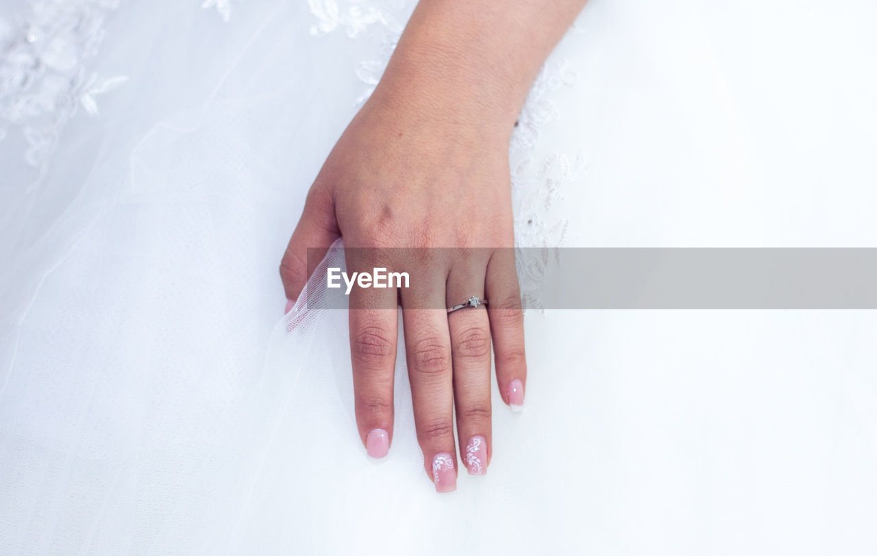 Close-Up Of Bride Wearing Ring