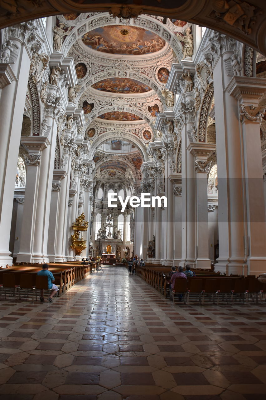 religion, place of worship, architecture, spirituality, architectural column, indoors, built structure, arch, history, pew, day, no people