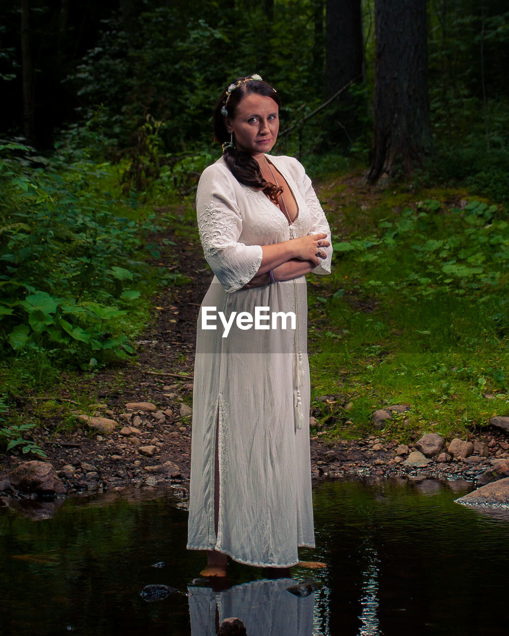 Portrait of mature woman standing in pond
