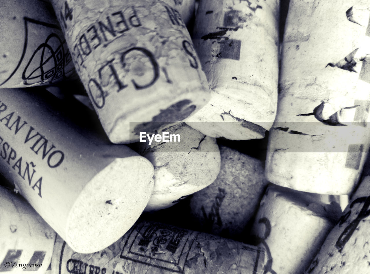 backgrounds, full frame, close-up, text, no people, communication, abundance, indoors, large group of objects, finance, heap, wealth, still life, number, western script, stack, old, business, wine cork, focus on foreground