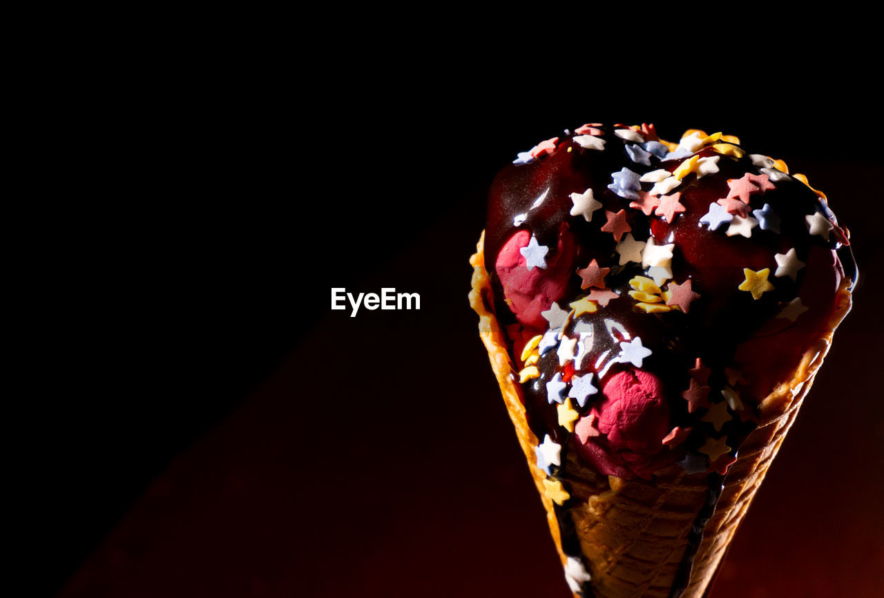 sweet food, sweet, unhealthy eating, indulgence, temptation, dessert, food and drink, freshness, food, ready-to-eat, still life, ice cream, copy space, indoors, sprinkles, frozen food, close-up, studio shot, dairy product, no people, black background, frozen sweet food