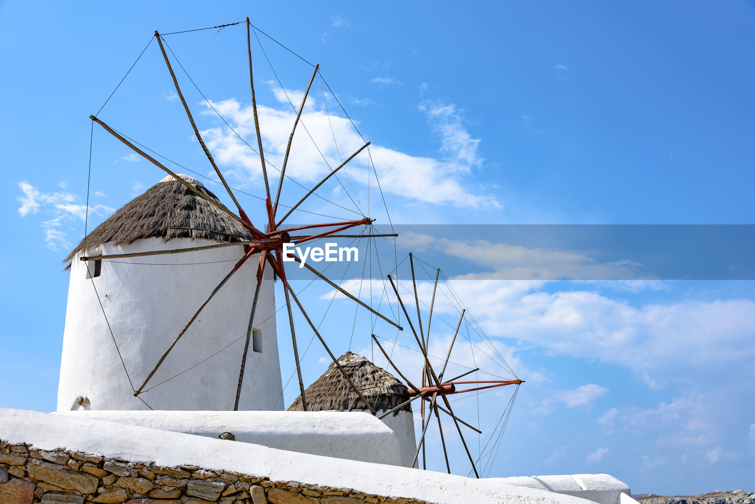 LOW ANGLE VIEW OF TRADITIONAL WINDMILLS AGAINST SKY