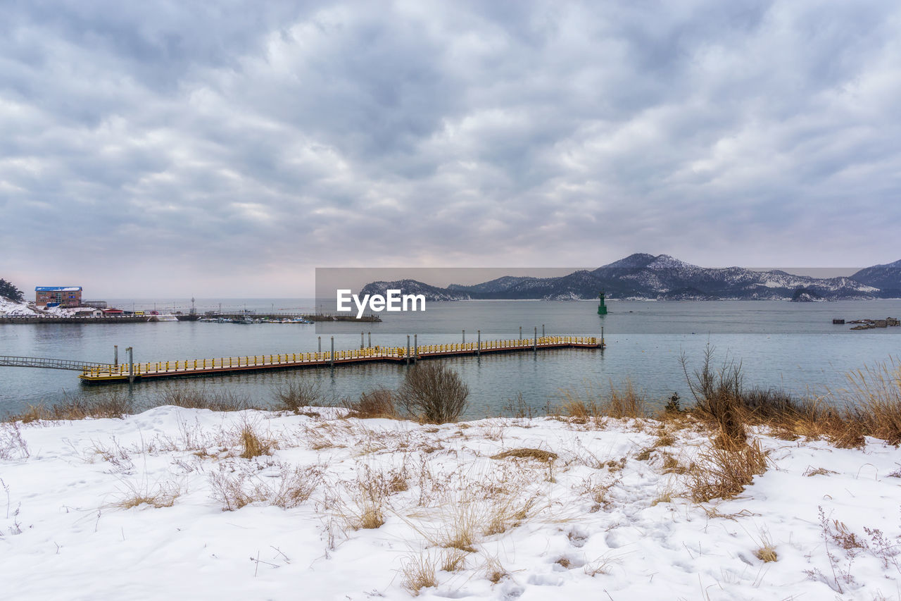 water, cloud - sky, sky, nature, beauty in nature, scenics - nature, tranquil scene, tranquility, no people, day, lake, winter, cold temperature, snow, outdoors, non-urban scene, idyllic
