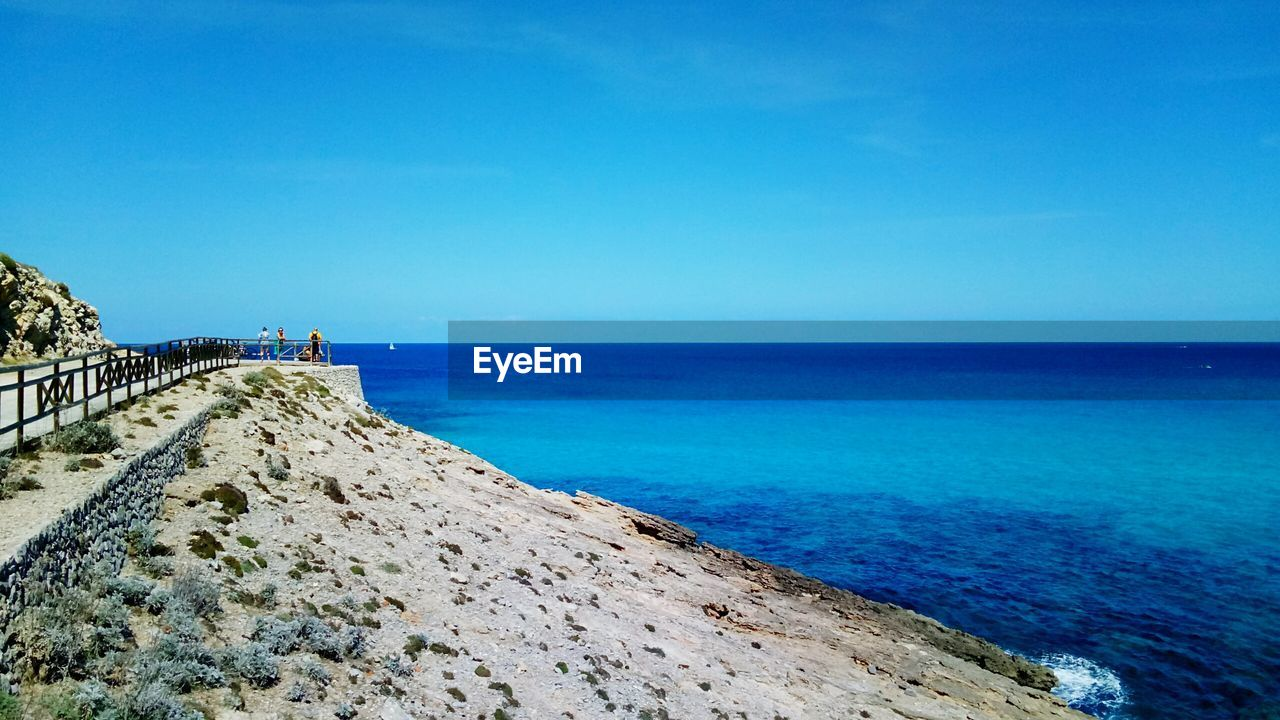 sea, sky, water, blue, horizon, horizon over water, scenics - nature, beauty in nature, beach, tranquil scene, land, tranquility, copy space, day, nature, clear sky, idyllic, non-urban scene, incidental people