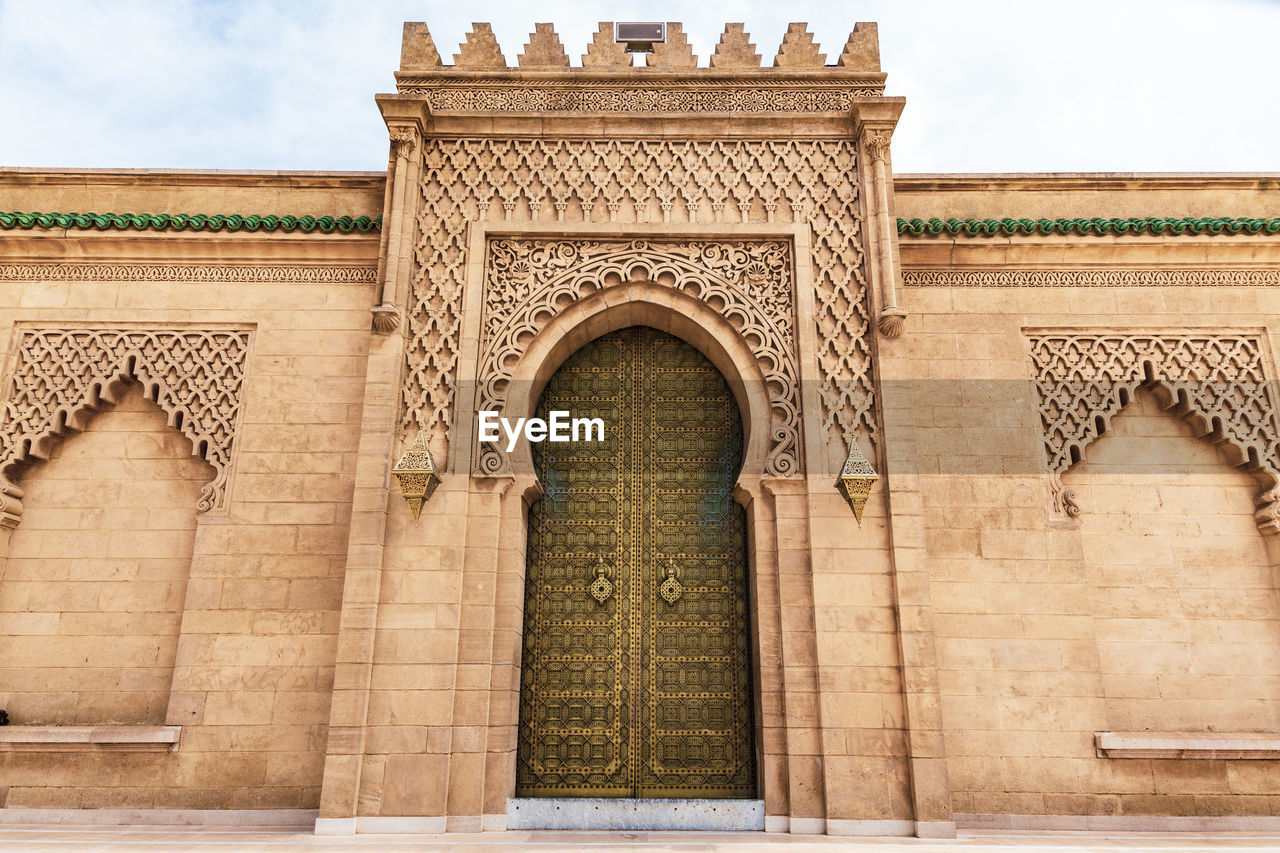 architecture, built structure, arch, the past, history, sky, building exterior, no people, travel destinations, day, low angle view, nature, entrance, tourism, city, building, travel, art and craft, craft, outdoors, ornate, architectural column, ancient civilization, place of worship