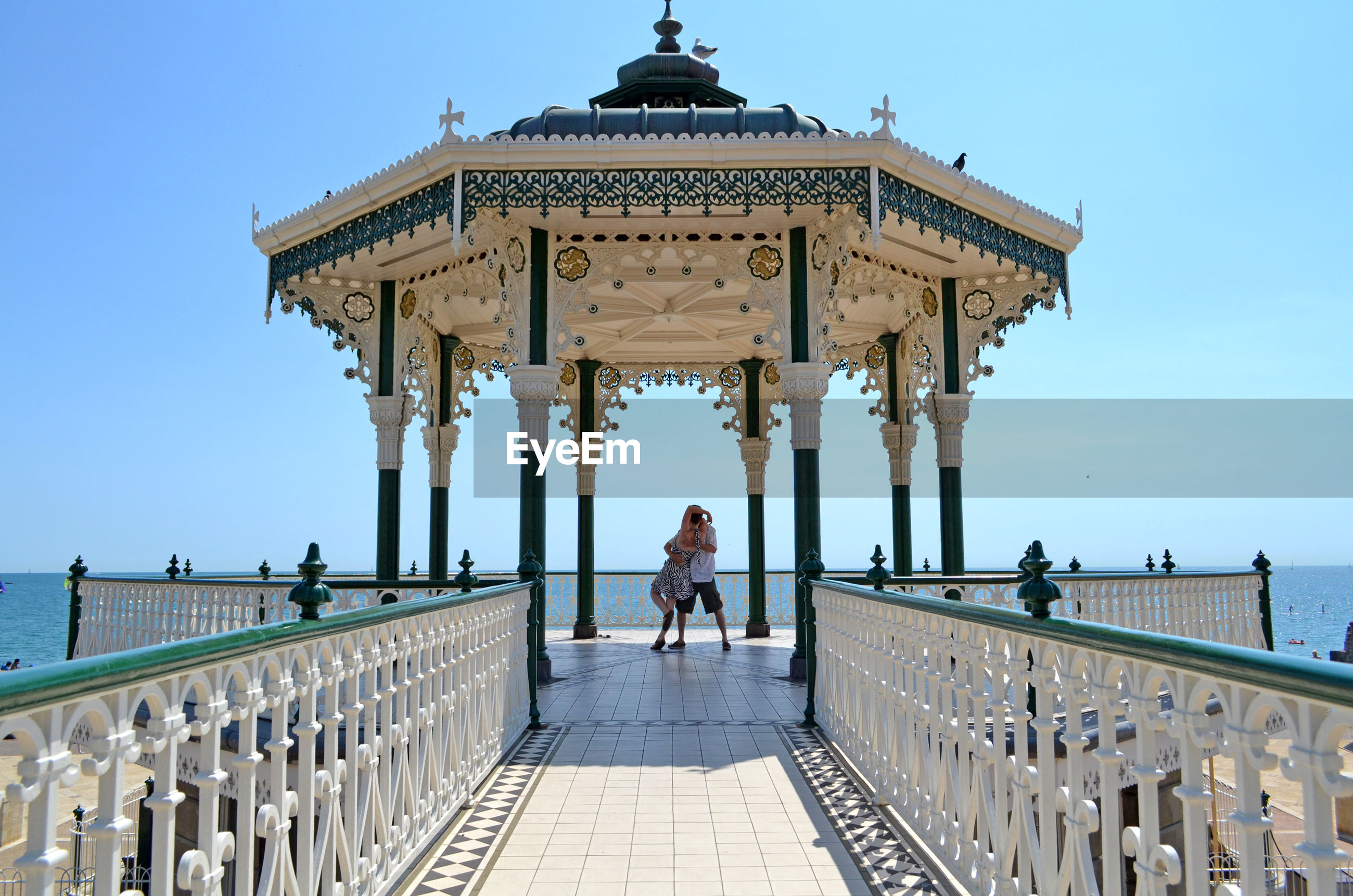 Couple embracing at ornate pier