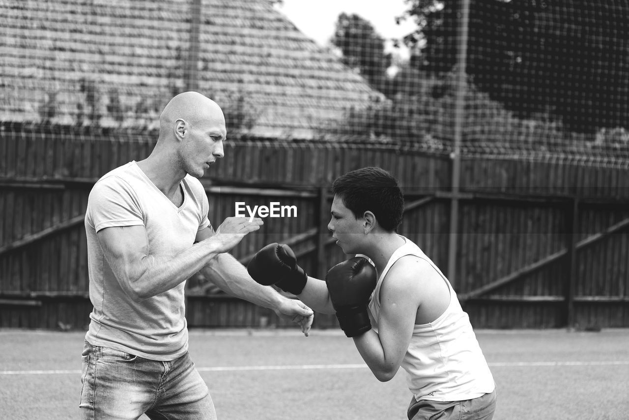 Man Training Boy To Box