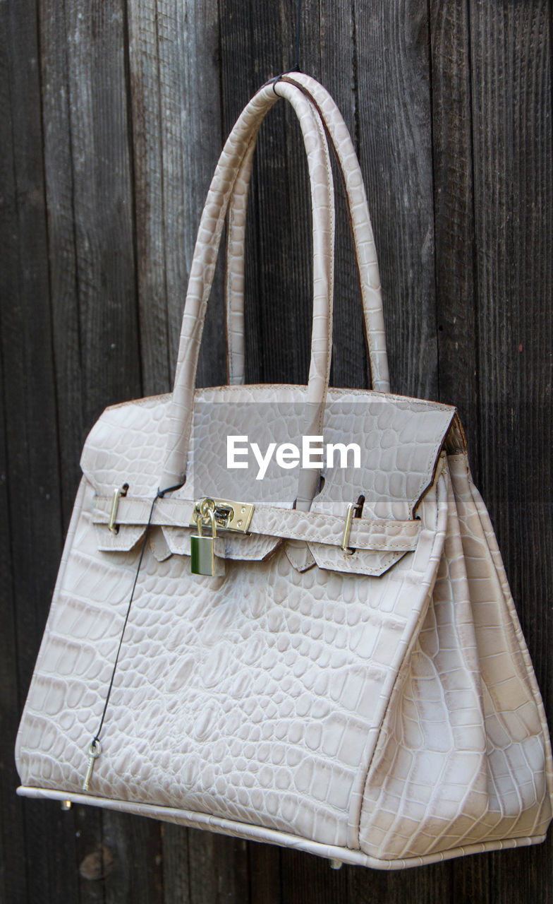 Close-up of bag hanging on wood