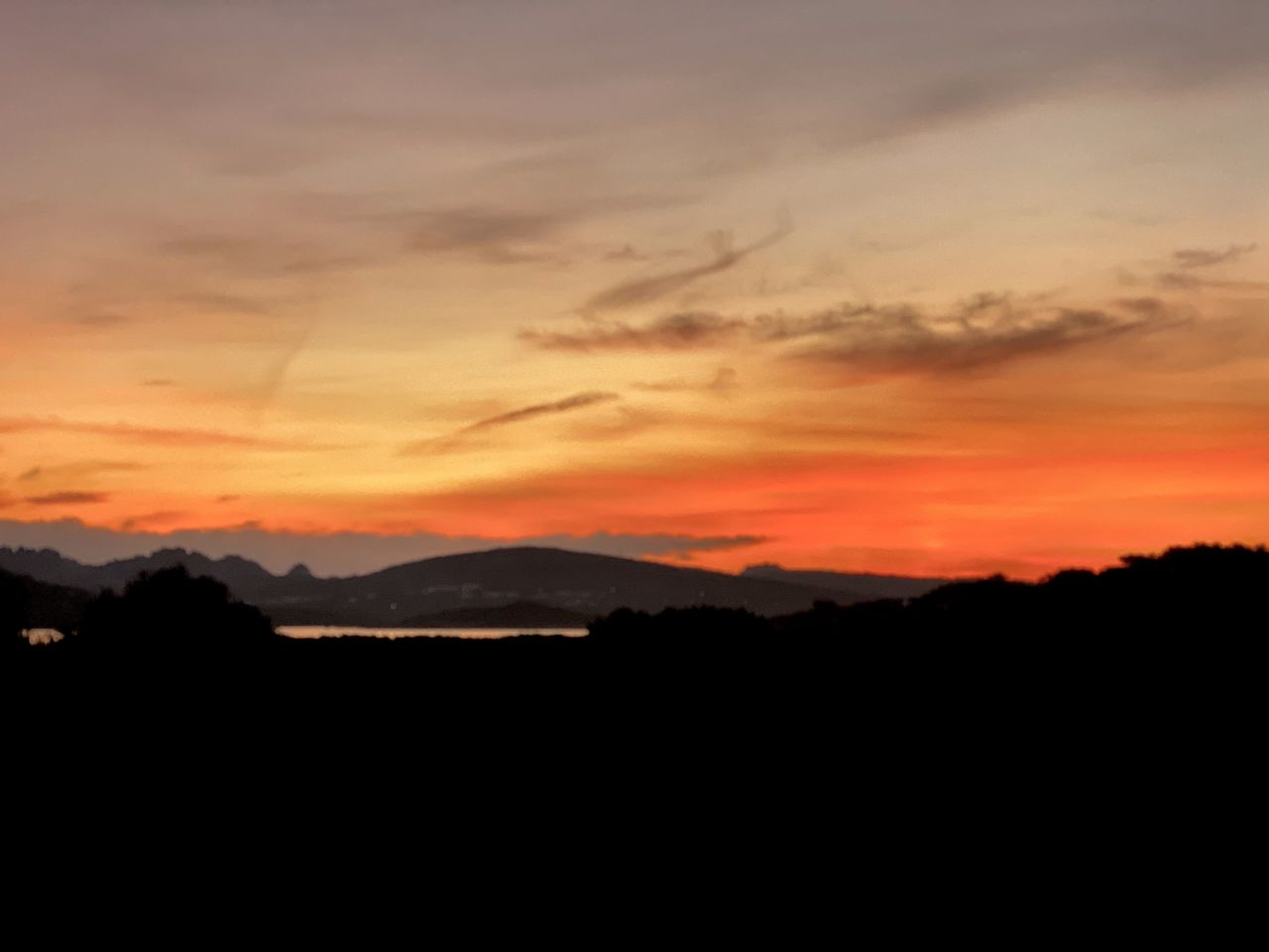 sunset, silhouette, sky, scenics - nature, beauty in nature, orange color, tranquil scene, tranquility, cloud - sky, nature, idyllic, no people, mountain, environment, landscape, outdoors, non-urban scene, copy space, dramatic sky, majestic