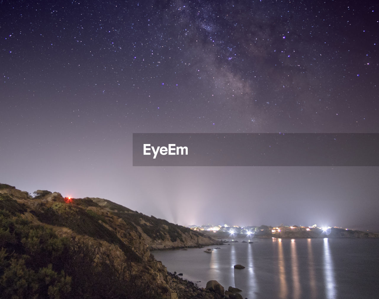 night, sky, star - space, water, beauty in nature, scenics - nature, space, astronomy, nature, star, no people, tranquility, tranquil scene, star field, galaxy, illuminated, waterfront, idyllic, rock, milky way