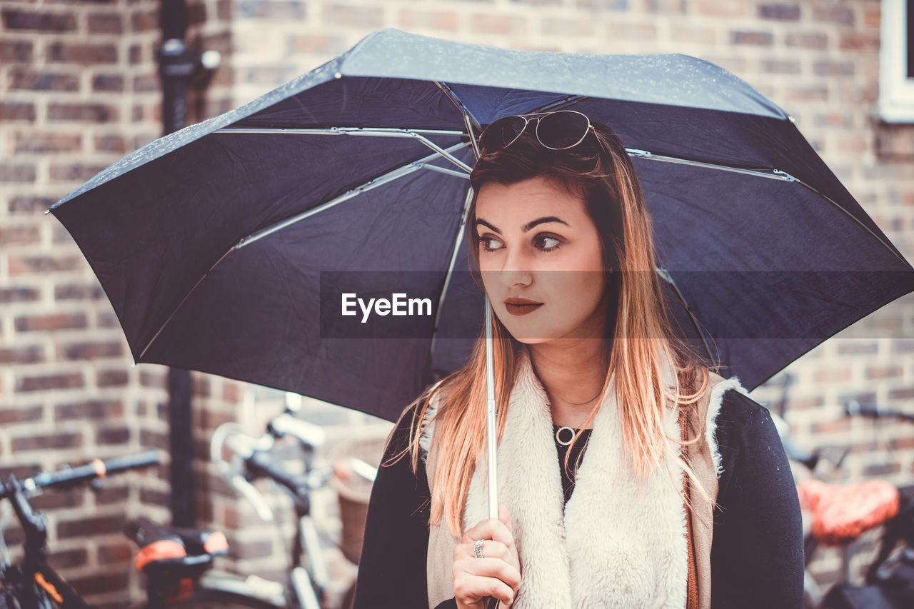Close-Up Of Beautiful Woman Holding Umbrella