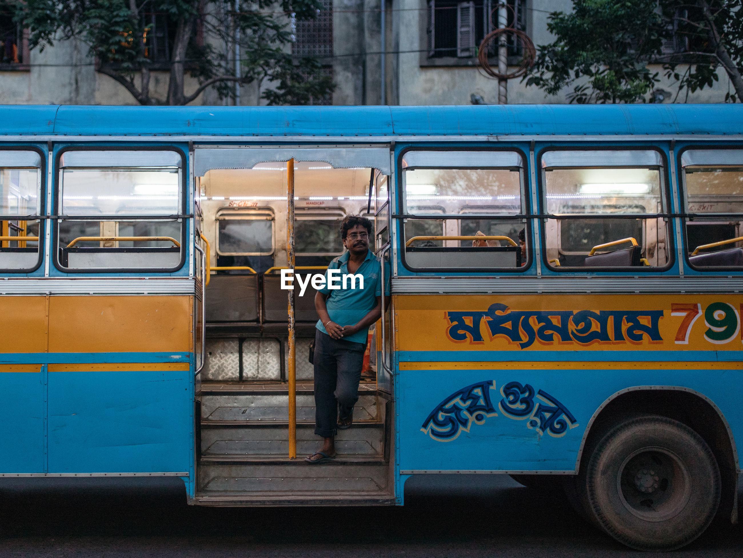 FULL LENGTH OF MAN ON BUS