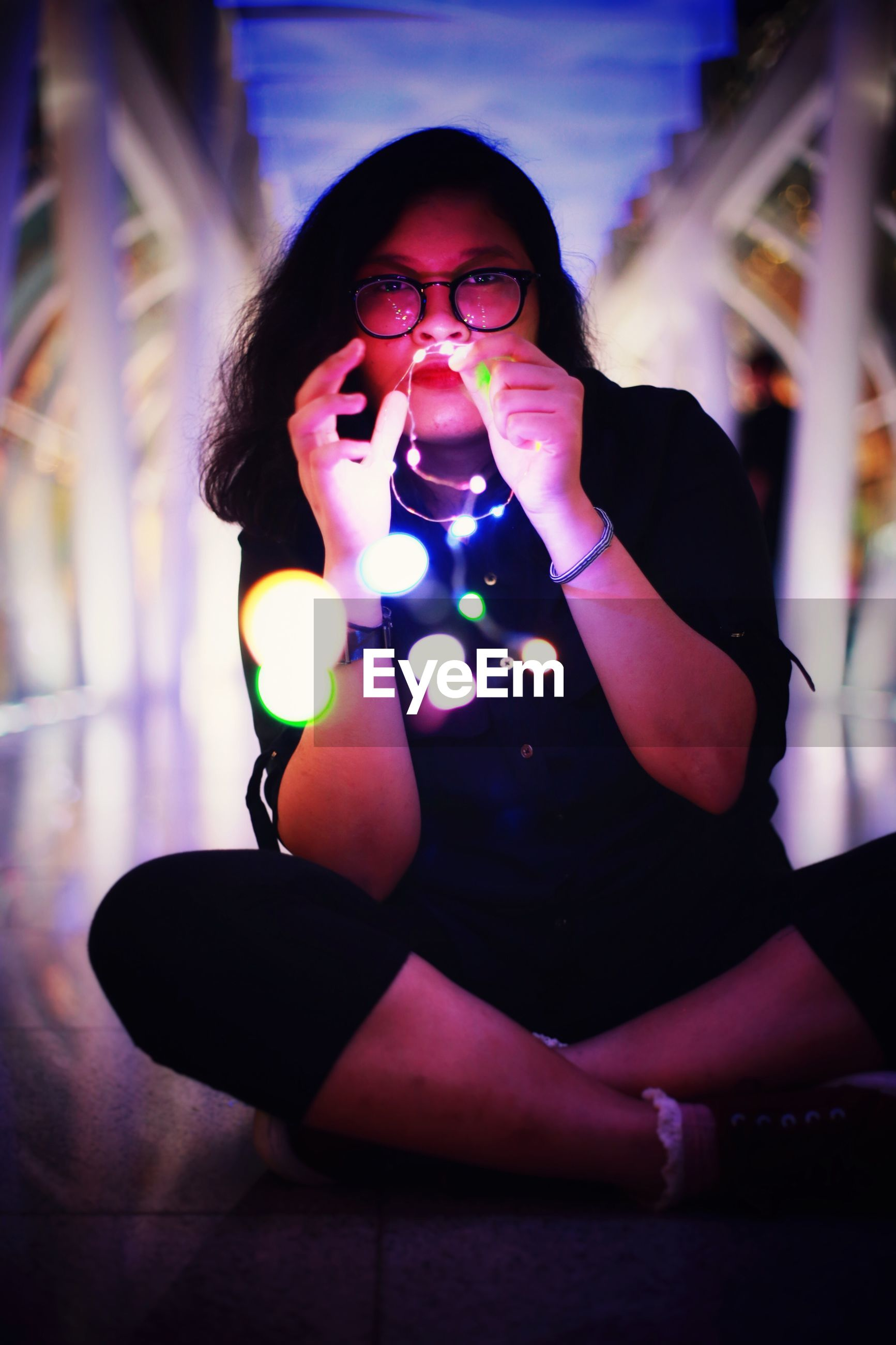 women, one person, eyeglasses, communication, wireless technology, night, business, lifestyles, business finance and industry, young women, indoors, businesswoman, young adult, only women, one woman only, adult, people, adults only