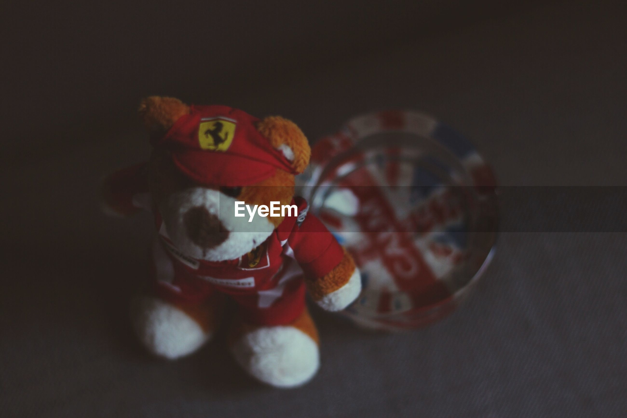 toy, still life, indoors, animal representation, close-up, animal themes, multi colored, art and craft, creativity, no people, art, single object, table, high angle view, one animal, childhood, ball, selective focus, copy space, red