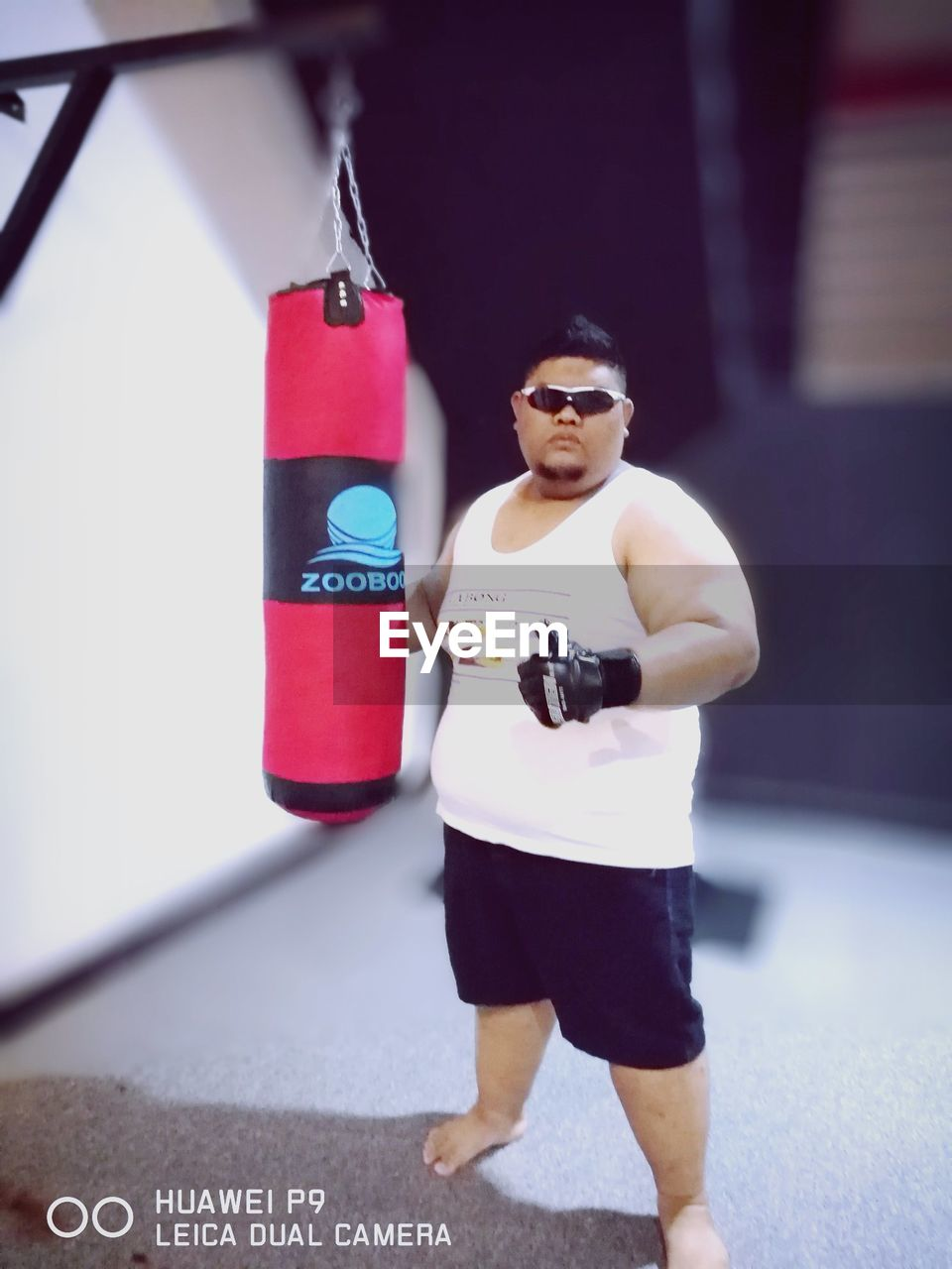 one person, full length, real people, indoors, lifestyles, sport, men, competition, boxing glove, day, young adult, boxing ring