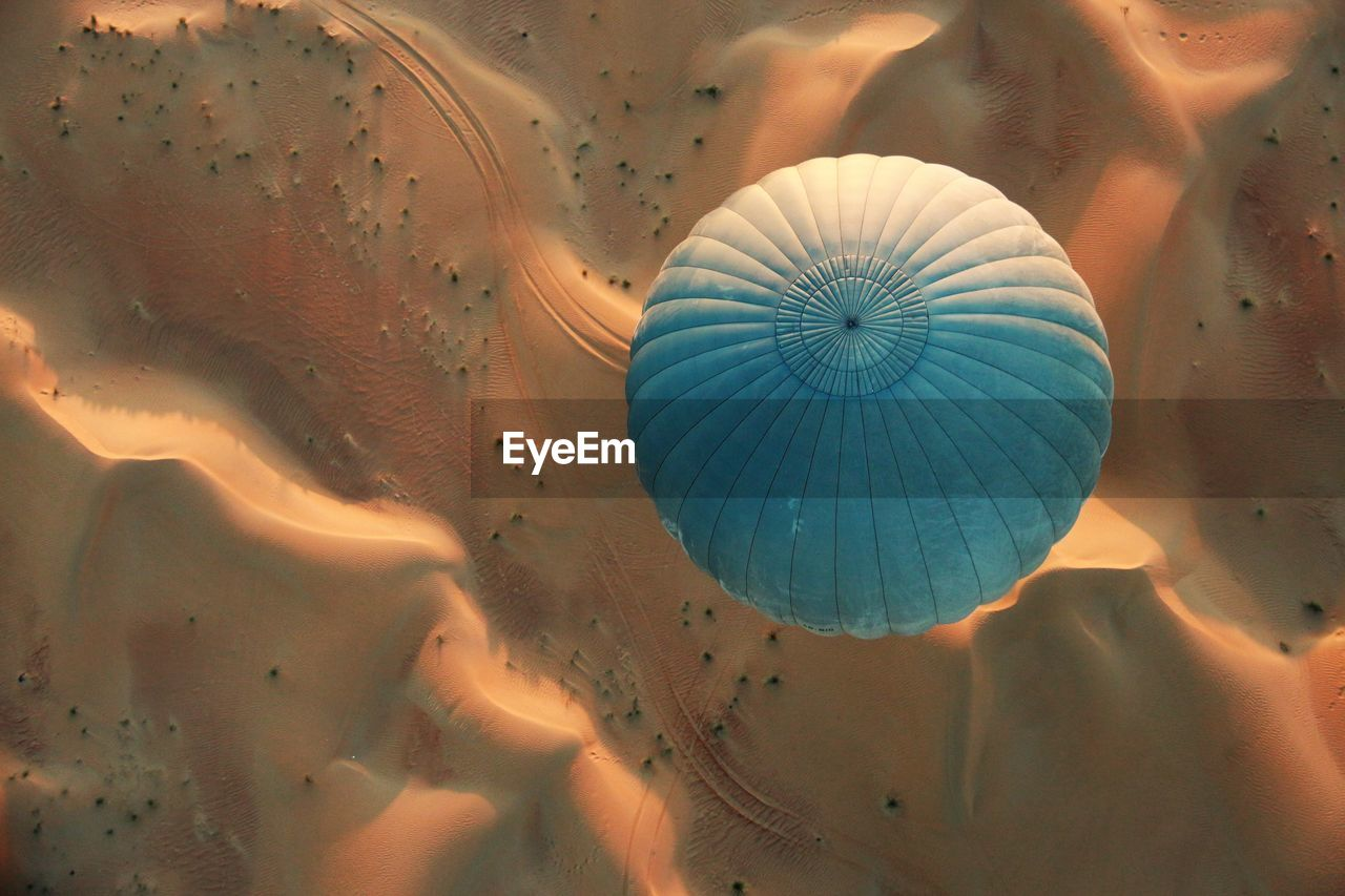 High Angle View Of Hot Air Balloon Over Sand