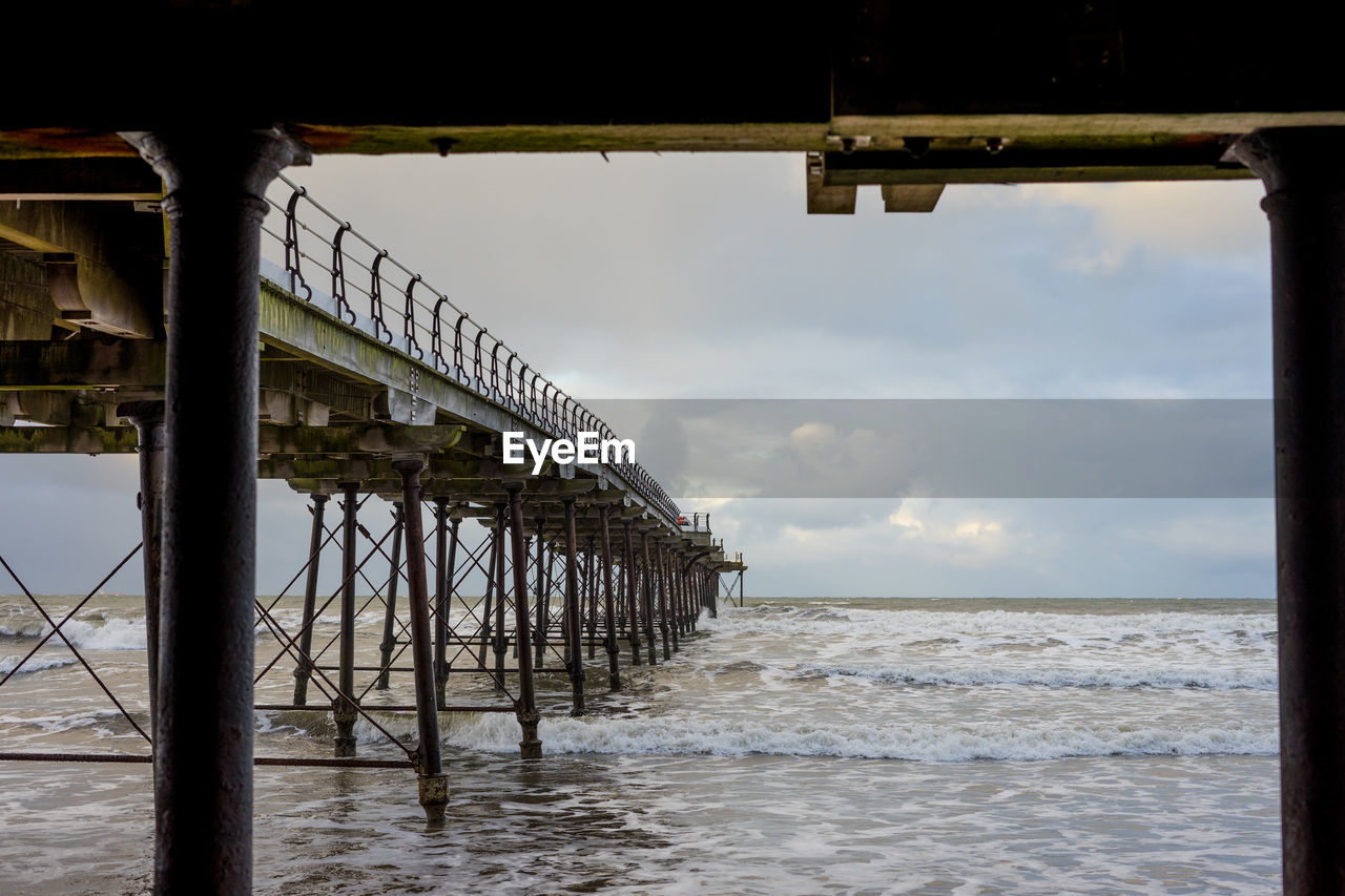 water, sea, architecture, built structure, sky, pier, no people, horizon over water, nature, cloud - sky, connection, architectural column, land, beach, horizon, bridge, motion, day, scenics - nature, outdoors, underneath