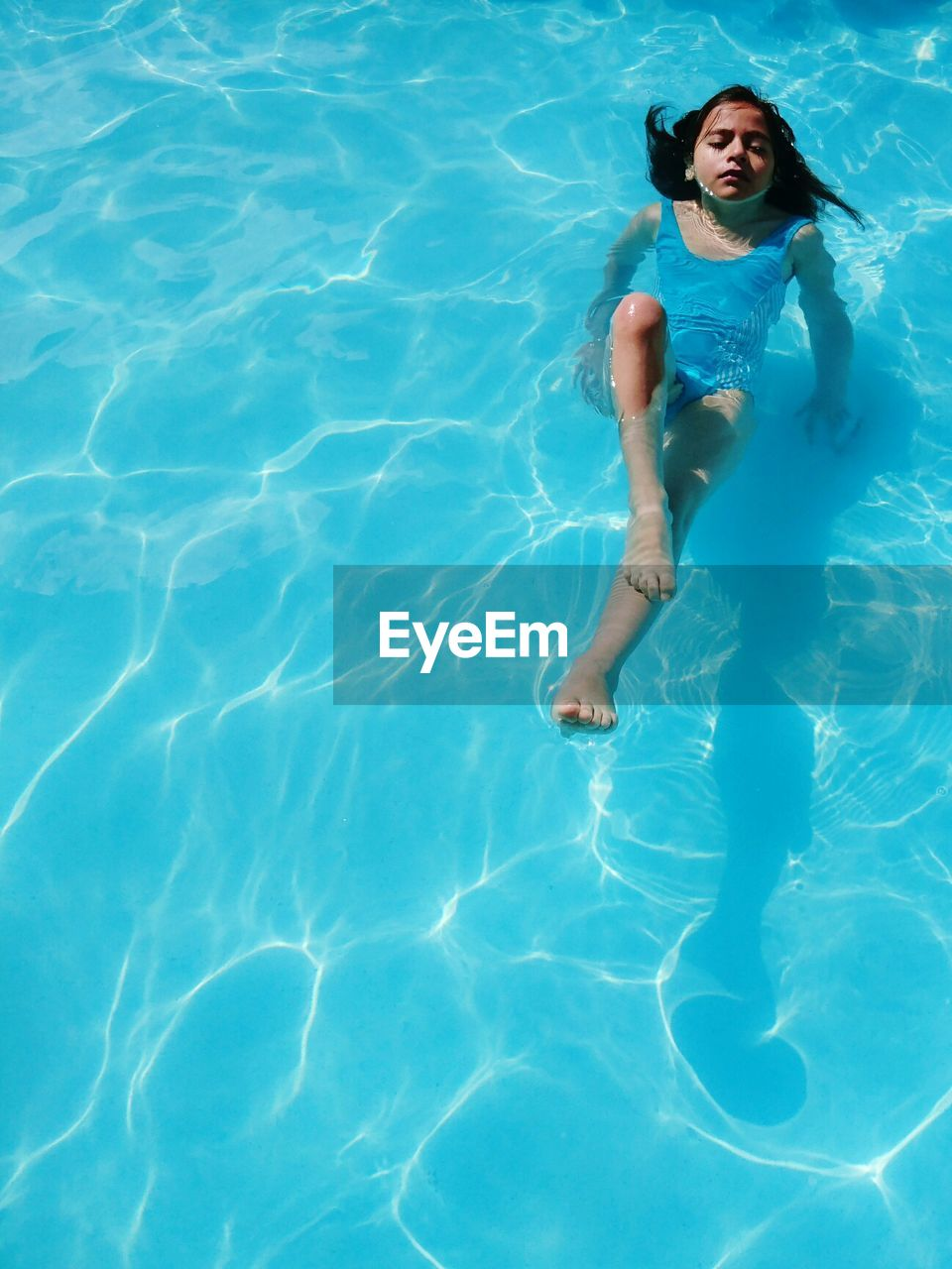 High Angle View Of Girl In Swimming In Pool