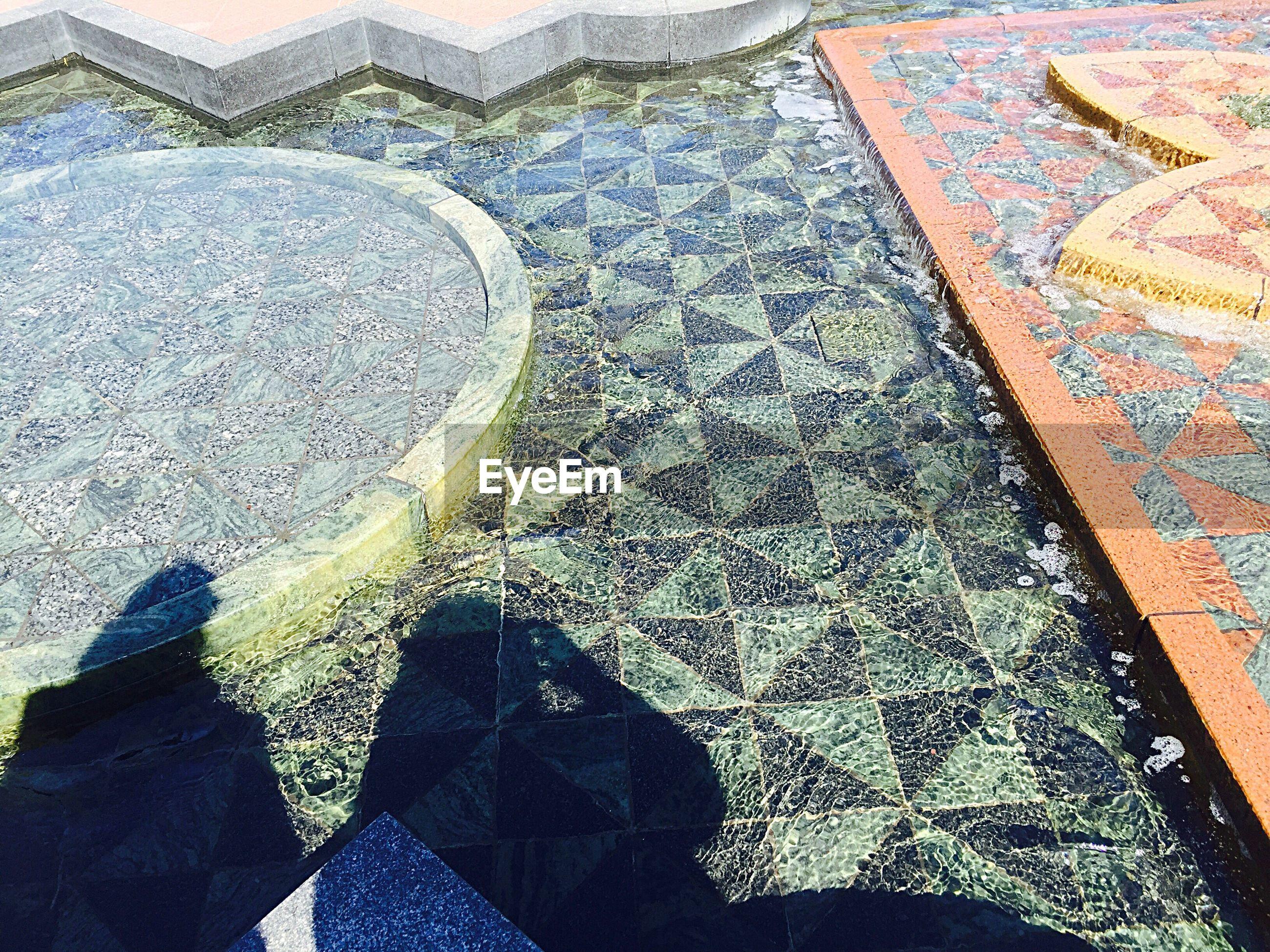 Shadow of people in pool