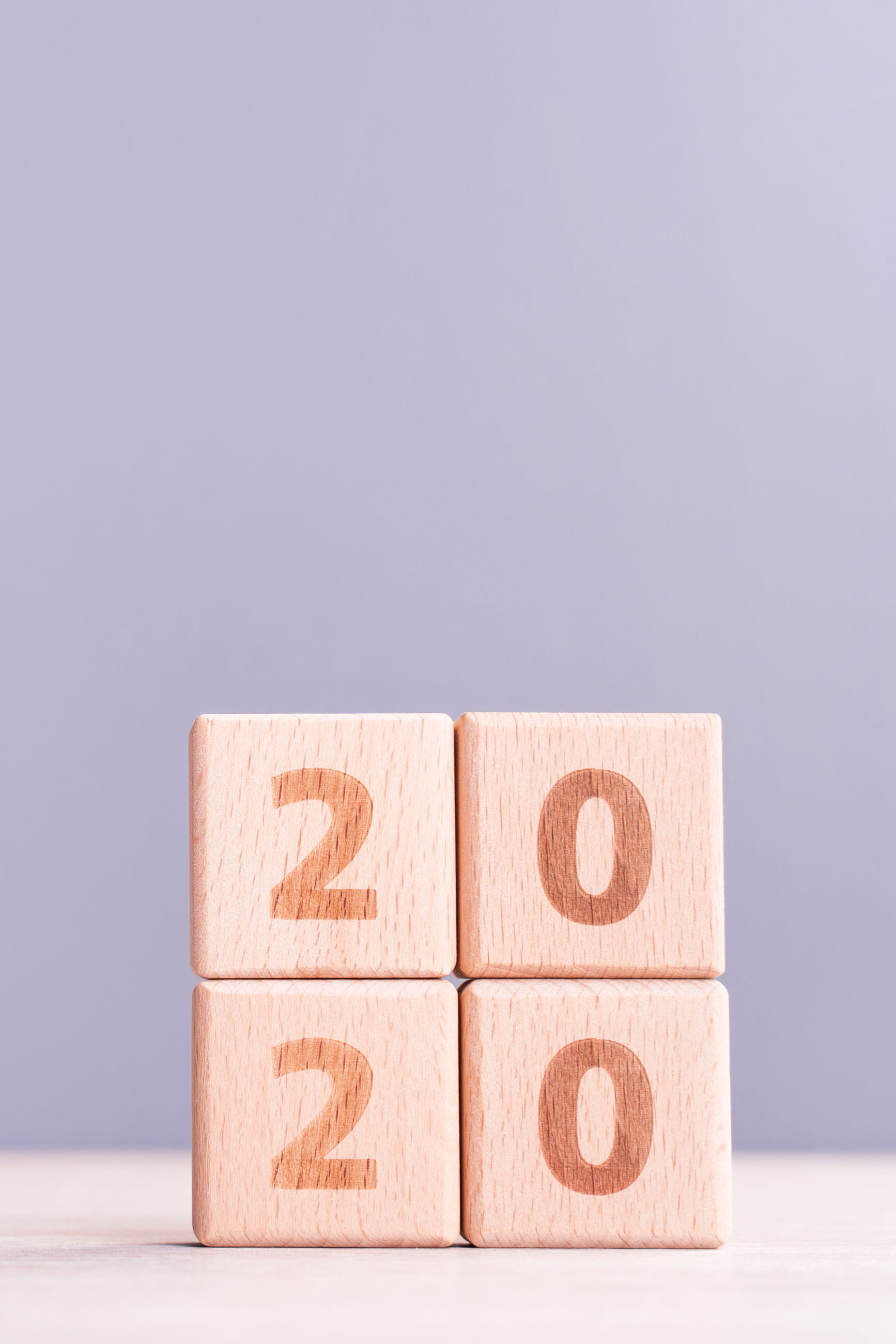 Close-up of toy blocks with 2020 number against gray background