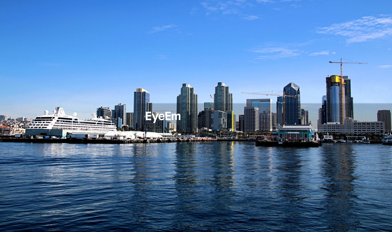 skyscraper, architecture, building exterior, city, built structure, water, waterfront, cityscape, urban skyline, outdoors, sky, no people, modern, river, travel destinations, blue, downtown district, day, nautical vessel