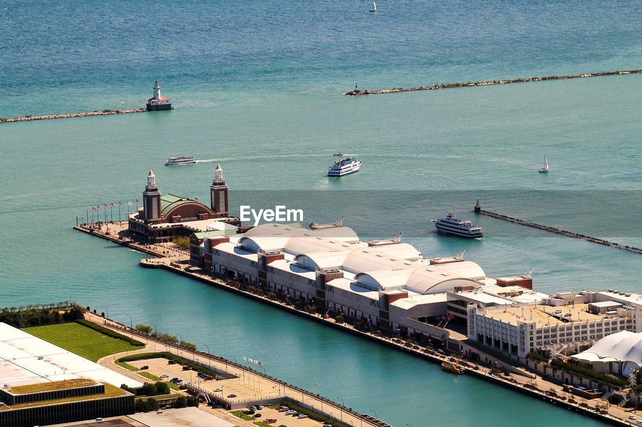 water, nautical vessel, transportation, mode of transportation, high angle view, sea, architecture, travel, built structure, nature, building exterior, day, moored, harbor, no people, ship, travel destinations, outdoors, sailing, sailboat, yacht