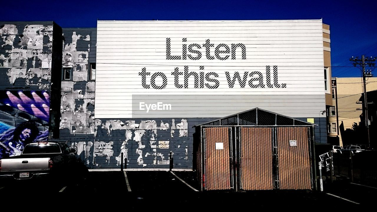 text, communication, day, architecture, built structure, outdoors, building exterior, no people, corrugated iron