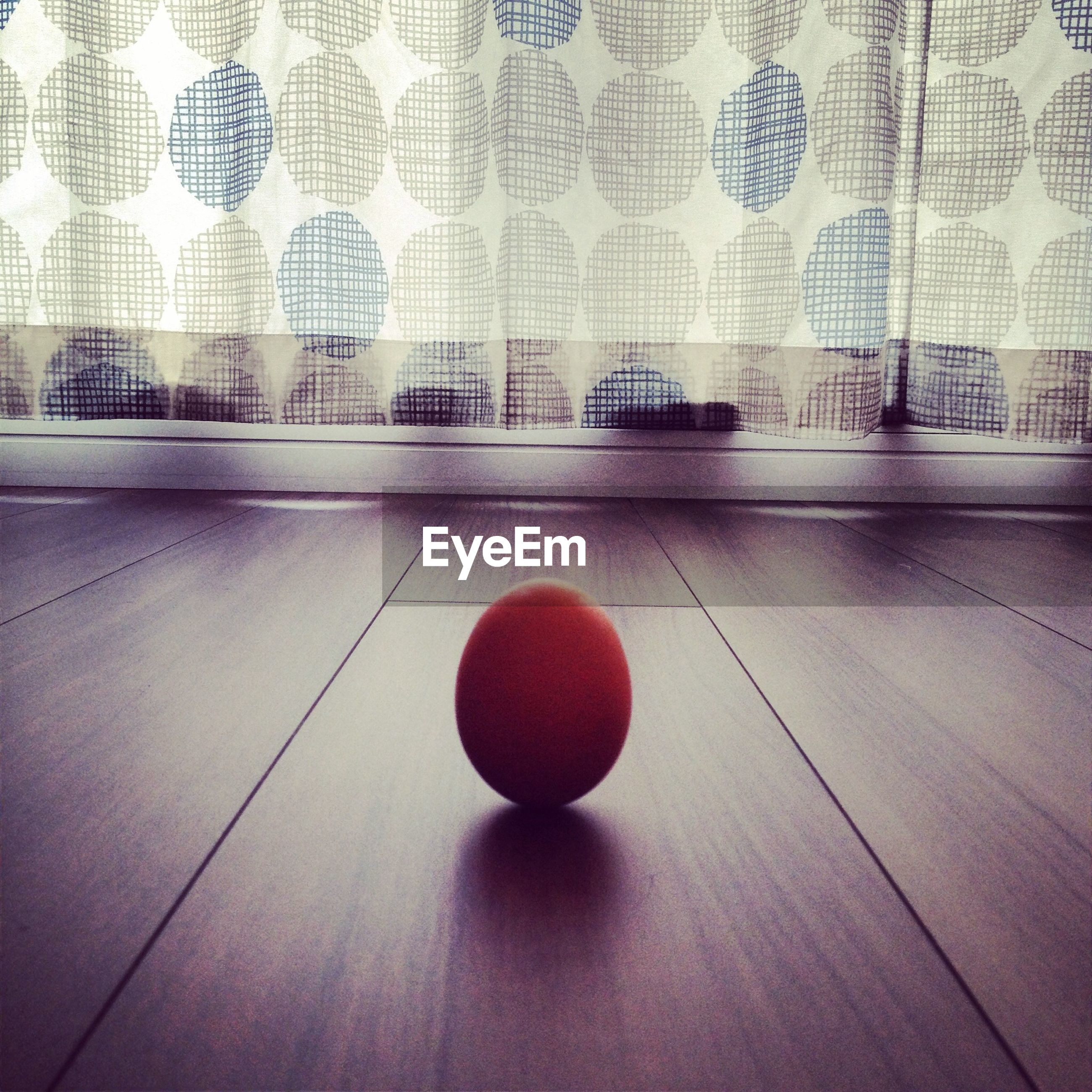 Egg on wooden floor at home