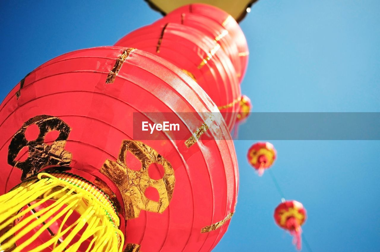 Low Angle View Of Lanterns Against Sky During Chinese New Year