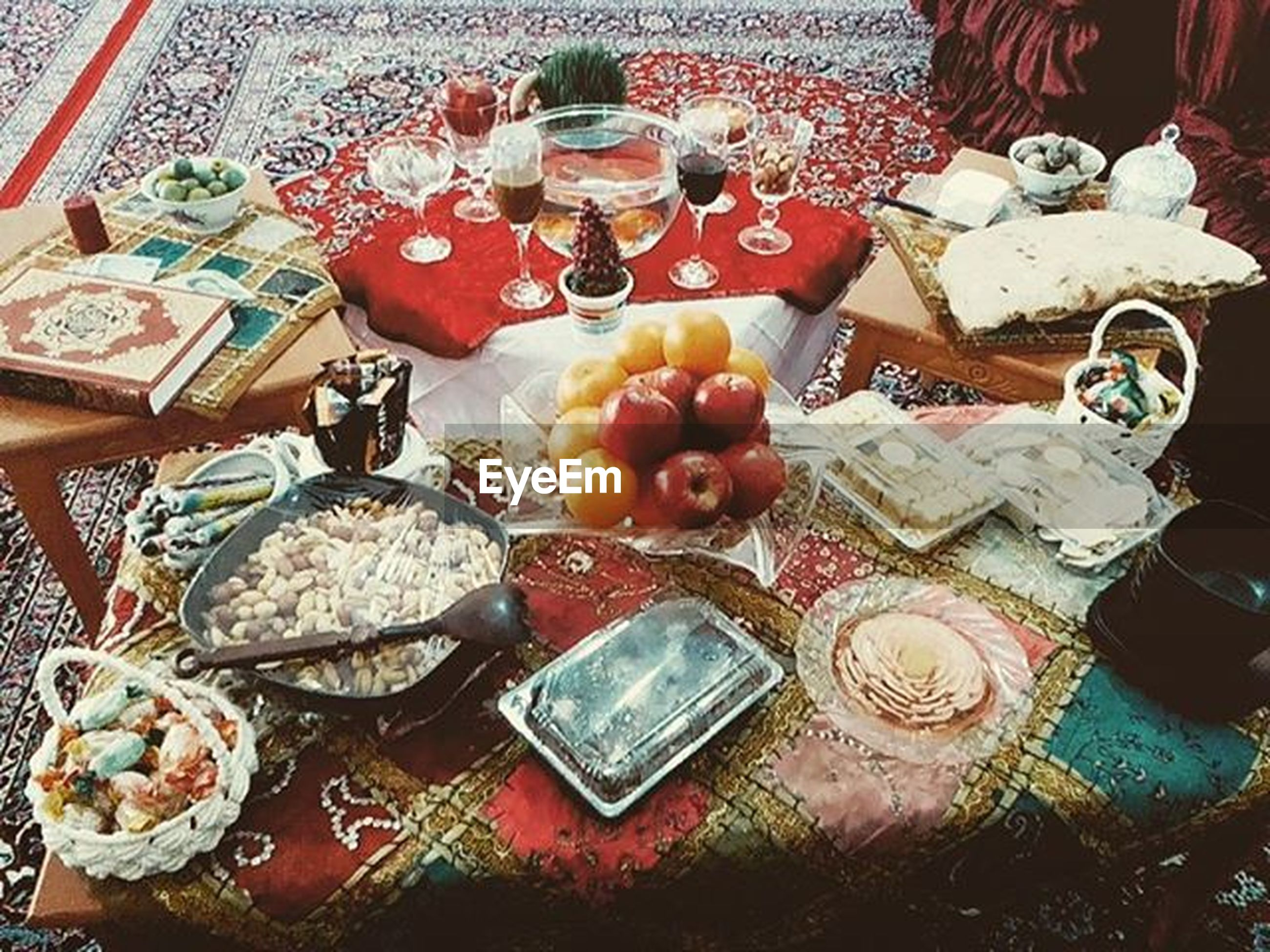 high angle view, indoors, variation, multi colored, still life, large group of objects, table, choice, abundance, bowl, art and craft, no people, container, arrangement, toy, collection, red, for sale, day, group of objects
